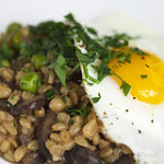 Wheat Berry Risotto with Mushrooms and Peas and Topped with an Egg