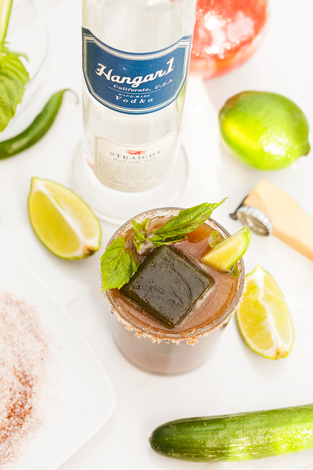 These are not your typical Bloody Marys! Spicy green ice cubes, cucumber soda, and @Hangar1Vodka make these unique! And did I mention super easy to make? | spachethespatula.com #recipe #Hangar1Vodka