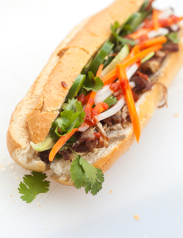 This outrageously delicious Vietnamese sandwich contains succulent roast pork shoulder, pork pâté, and homemade pickles! | spachethespatula.com #recipe