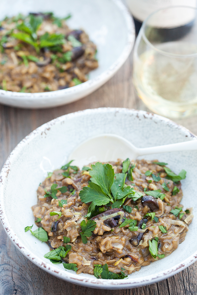 A secret ingredient packs a wallop of mushroom flavor into the creamy, decadent dish. It's the BEST mushroom risotto I've ever tried!   spachethespatula.com #recipe