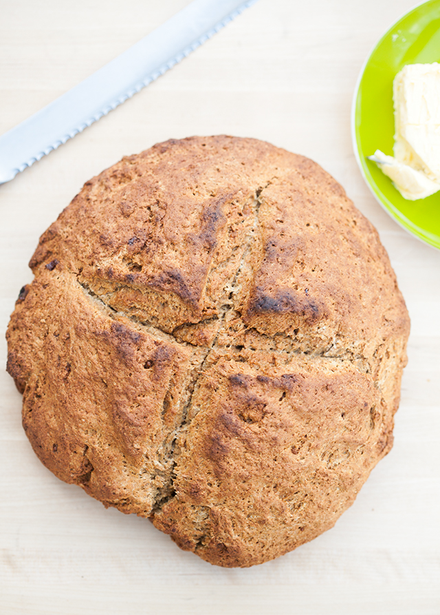 This slightly sweet, nutty, yeast-less bread has a crunchy outside and a super tender inside. Serve it with a creamy Irish butter for ultimate enjoyment! spachethespatula.com #recipe