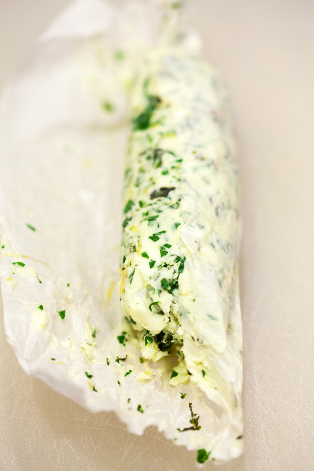 Dress up your favorite savory recipes with this fresh and vibrant compound butter using lemon and a variety of herbs! | spachethespatula.com #recipe