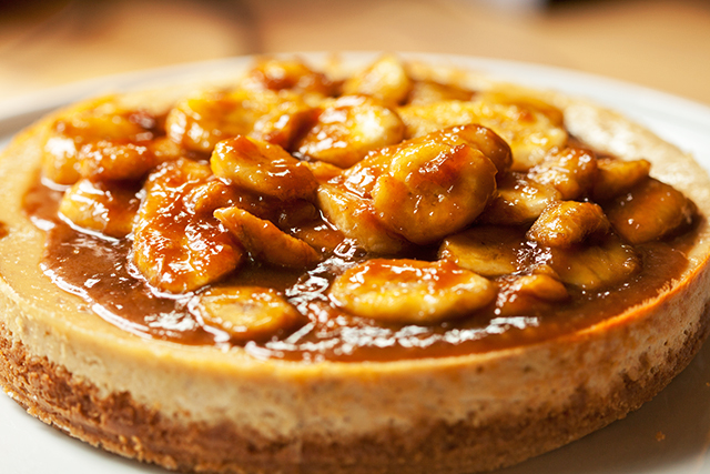 A Do-Si-Do Girl Scout cookie base, a peanut butter & banana cheesecake filling, and a bananas foster topping...it doesn't get any better than this folks! | spachethespatula.com #recipe