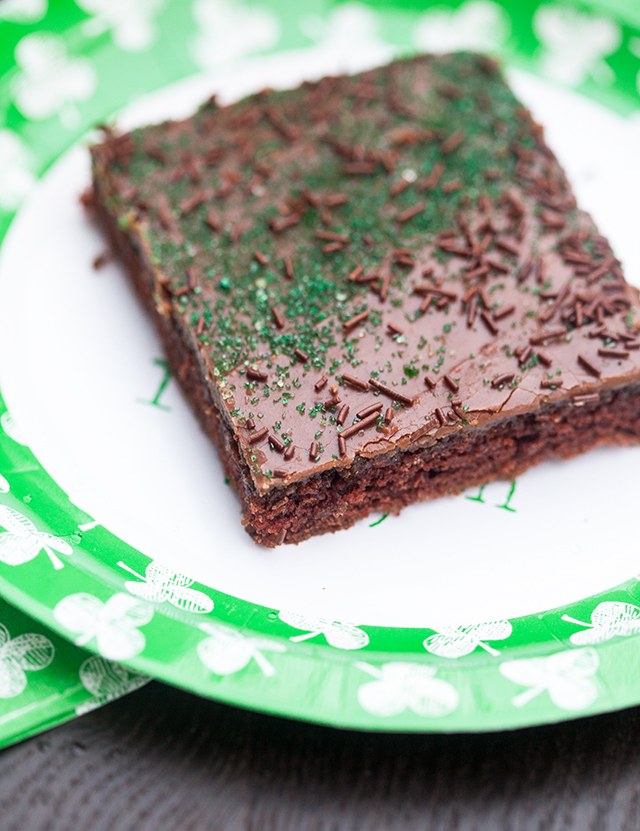 The moistest chocolate sheet cake with creamy chocolate icing, spiked with Guinness beer---this is the BEST sheet cake you will ever try! | spachethespatula.com #recipe