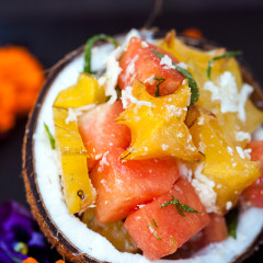 A vibrantly refreshing and tropical fruit salad full of fresh coconut! | spachethespatula.com #recipe