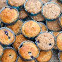 You choose---Whole grain and refined sugar-free? or a more standard AP flour and sugar version! Both contain tons of blueberries and are less than 100 calories each! | spachethespatula.com #recipe