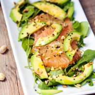 A vibrant, juicy salad with creamy avocado, peppery arugula, and unctuous pistachios oil | spachethespatula.com #recipe