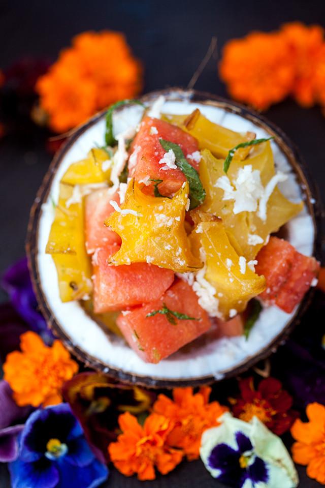 A vibrantly refreshing and tropical fruit salad full of fresh coconut! | spachethespatula.com #recipe