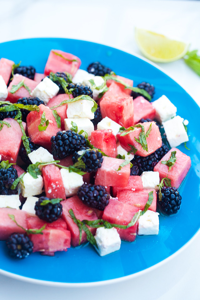 Refreshing fruit, salty feta, and tangy-sweet dressing---this is a perfect salad for warmer weather! | spachethespatula.com #recipe