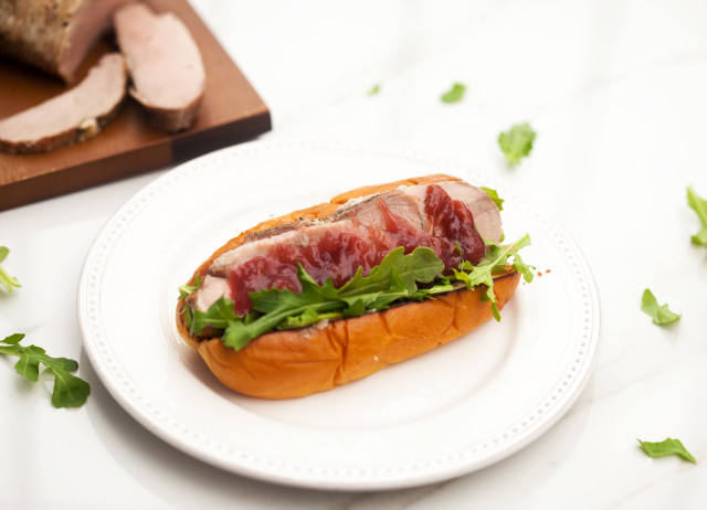 Super moist and flavorful pork loin, spicy arugula, and a homemade cherry sauce all stuffed in a Hawaiian bun! | spachethespatula.com #recipe