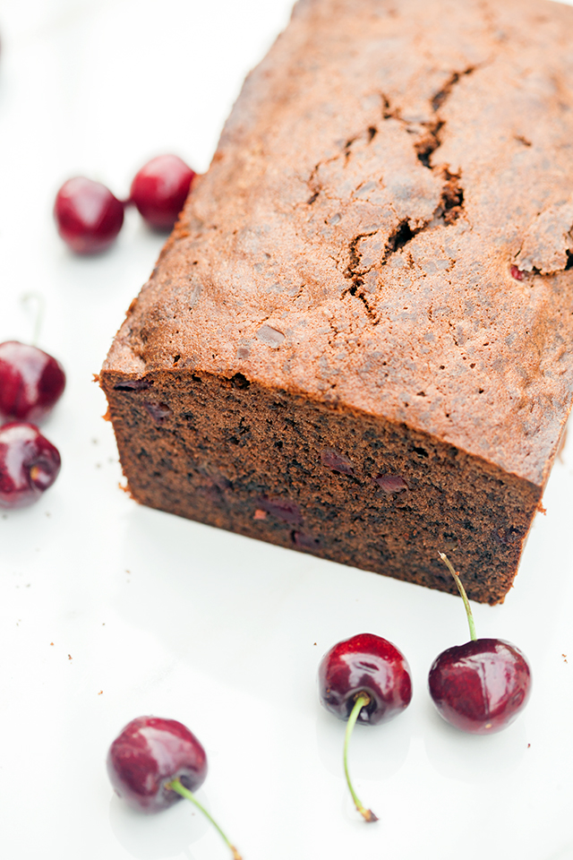 A dense, rich, and chocolatey pound cake, studded with pieces of fresh, juicy cherries!   spachethespatula.com #recipe