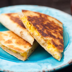 Creamy, cheesy scrambled eggs stuffed inside a crisp, golden brown tortilla! | spachethespatula.com #recipe