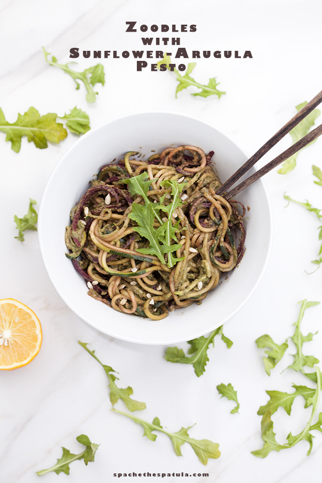 Zucchini and beet noodles tossed in a super flavorful pesto---this salad/noodle dish is so super tasty! #vegan | spachethespatula.com #recipe