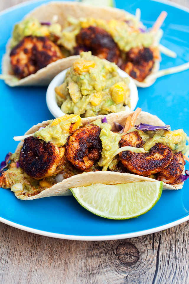 Bold and spicy shrimp pair perfectly with fruity and creamy mango guacamole! | spachethespatula.com #recipe