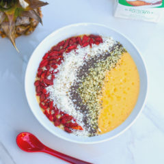 Tropical fruit and a nutrient-dense base make up this gorgeous smoothie bowl! #RootedinNutrition | spachethespatula.com #recipe #vegan