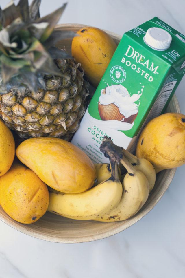 Tropical fruit and a nutrient-dense base make up this gorgeous smoothie bowl! #RootedinNutrition   spachethespatula.com #recipe #vegan
