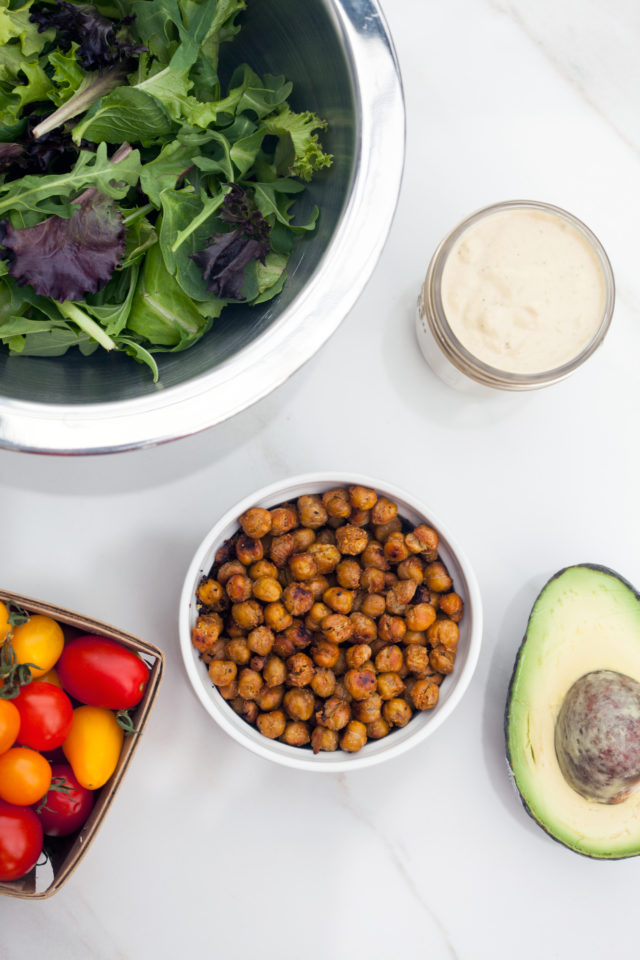 A crazy tasty #vegan caesar dressing, crunchy spiced chickpeas, creamy avocado, and sweet tomatoes make for an incredible lunch option! | spachethespatula.com #recipe