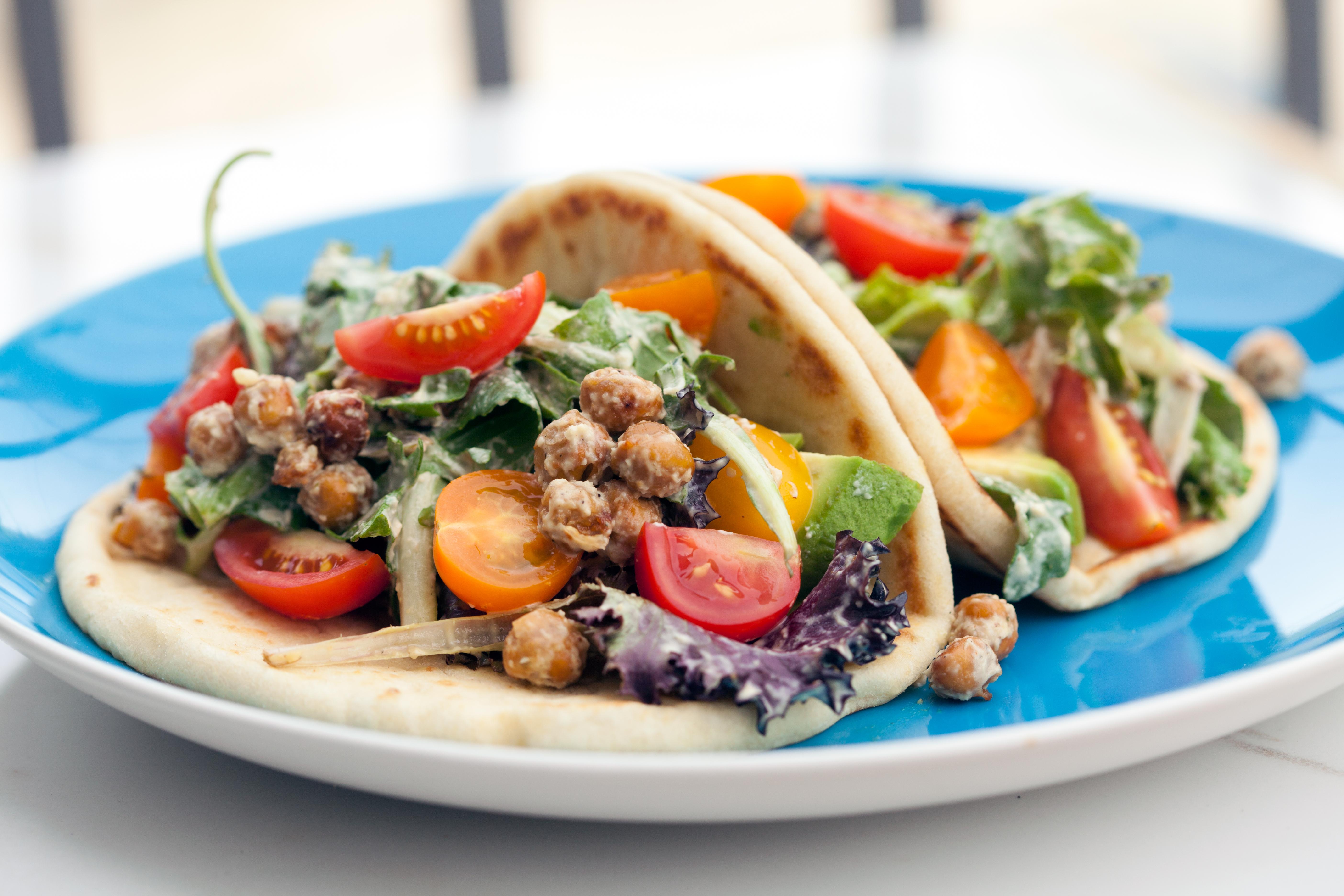 A crazy tasty #vegan caesar dressing, crunchy spiced chickpeas, creamy avocado, and sweet tomatoes make for an incredible lunch option! | spachethespatula.com #recipe