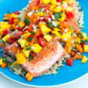 A fresh and vibrant mango salsa tops seared salmon fillets in the perfect Summer dish! | spachethespatula.com #recipe